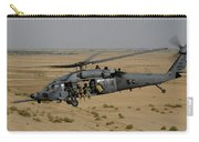 A U.s. Air Force Hh-60 Pavehawk Flies Carry-all Pouch