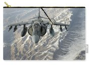 An Av-8b Harrier Receives Fuel Carry-all Pouch