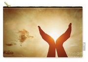 Raised Hands Catching Sun On Sunset Sky. Concept Of Spirituality, Wellbeing, Positive Energy Carry-all Pouch