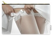 Woman Putting On White Stockings Carry-all Pouch