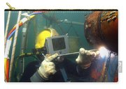 U.s. Navy Diver Welds A Repair Patch Carry-all Pouch by Stocktrek Images