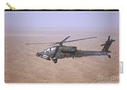 An Ah-64d Apache Longbow Fires A Hydra Carry-all Pouch