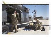 Pararescuemen Sorts Out His Gear Carry-all Pouch