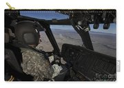 Pilot Operating The Cockpit Of A Uh-60 Carry-all Pouch