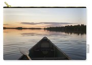 A Boat And Paddle On A Tranquil Lake Carry-all Pouch