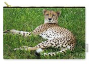 A Cheetah Resting On The Grass Carry-all Pouch