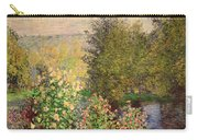 A Corner Of The Garden At Montgeron Carry-all Pouch by Claude Monet