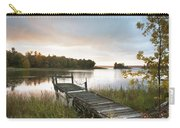 A Dock On A Lake At Sunrise Near Wawa Carry-all Pouch