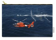 A Helicopter Crew Trains Off The Coast Carry-all Pouch by Stocktrek Images