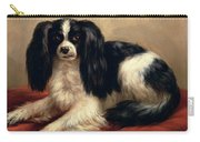 A King Charles Spaniel Seated On A Red Cushion Carry-all Pouch