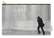 A Silhouette Of The Boy Against A Fountain Carry-all Pouch