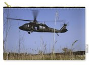A U.s. Army Uh-60 Black Hawk Helicopter Carry-all Pouch by Stocktrek Images