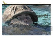 A U.s. Marine Swims Across A Training Carry-all Pouch