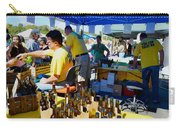 A Vendor At The Garlic Fest Offers Garlic Vinegar And Olive Oil For Sale Carry-all Pouch