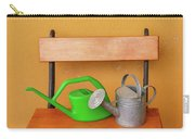 A Watering Can Of  Aluminium And A Plastic One Laid On Wooden Bench Carry-all Pouch