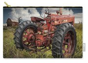 Abandoned Old Farmall Tractor In A Grassy Field Carry-all Pouch