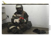 Airman Dons His Chemical Warfare Carry-all Pouch