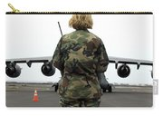 An Airfield Manager Greets An Arriving Carry-all Pouch