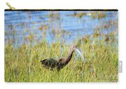 An Ibis In The Grass Carry-all Pouch