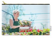 Attractive Gardener Selecting Flowers In A Gardening Center. Carry-all Pouch