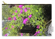 Beutiful Flowers Hang The Wall . Carry-all Pouch