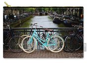 Bicycle Parked At The Bridge In Amsterdam. Netherlands. Europe Carry-all Pouch