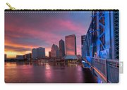 Blue Bridge Red Sky Jacksonville Skyline Carry-all Pouch by Debra and Dave Vanderlaan