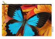 Blue Butterfly On Brightly Colored Flowers Carry-all Pouch by Garry Gay