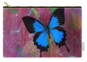 Blue Butterfly On Colorful Wooden Wall Carry-all Pouch