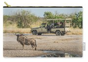 Blue Wildebeest Beside Puddle With Jeep Behind Carry-all Pouch