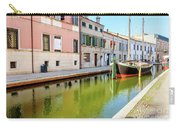 boat in a canal of the colorful italian village of Comacchio in  Carry-all Pouch