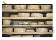 Cheese Wheels On Wooden Shelves In The Cheese Store Carry-all Pouch