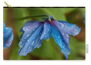 Close-up Of Raindrops On Blue Flowers Carry-all Pouch