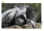 Closeup Of Black And White Angolian Primate Sleeping On Log Raft Carry-all Pouch