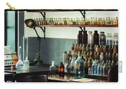 Desk With Bottles Of Chemicals Carry-all Pouch