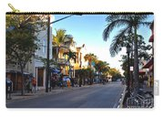 Duval Street In Key West Carry-all Pouch by Susanne Van Hulst