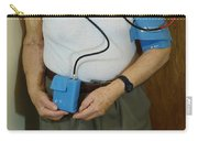 Elderly Man Wearing A Blood Pressure Carry-all Pouch
