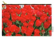 Field Of Brilliant Red Tulip Flowers In A Garden Carry-all Pouch