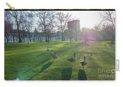 Five Ducks Walking In Line At Sunset With London Museum In The B Carry-all Pouch
