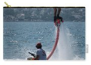 Flyboarder In Pink Shorts Above Jet Ski Carry-all Pouch