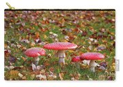 Four Fly Agarics Among Dead Leaves Carry-all Pouch