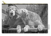 Golden Retrievers The Kiss Black And White Carry-all Pouch by Jennie Marie Schell