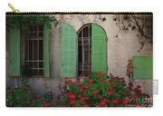 Green Windows And Red Geranium Flowers Carry-all Pouch by Yair Karelic