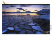 Ice Flakes Drifting Against The Sunset Carry-all Pouch by Arild Heitmann