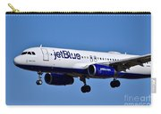 jetBlue Airlines plane in flight Carry-all Pouch