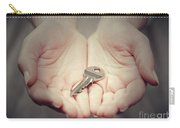Key In Woman's Hand In Gesture Of Giving. Concept Of Success In Live, Business Solution, Real Estate Etc Carry-all Pouch