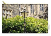 Lamppost In Front Of Green Bushes And Old Walls. Carry-all Pouch