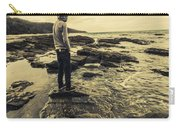 Man Gazing Out On Coastal Rocks Carry-all Pouch