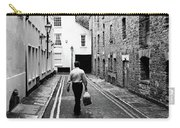 Man Walking With Shopping Bag Down Narrow English Street Carry-all Pouch