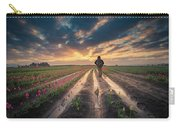 Man Watching Sunrise In Tulip Field Carry-all Pouch